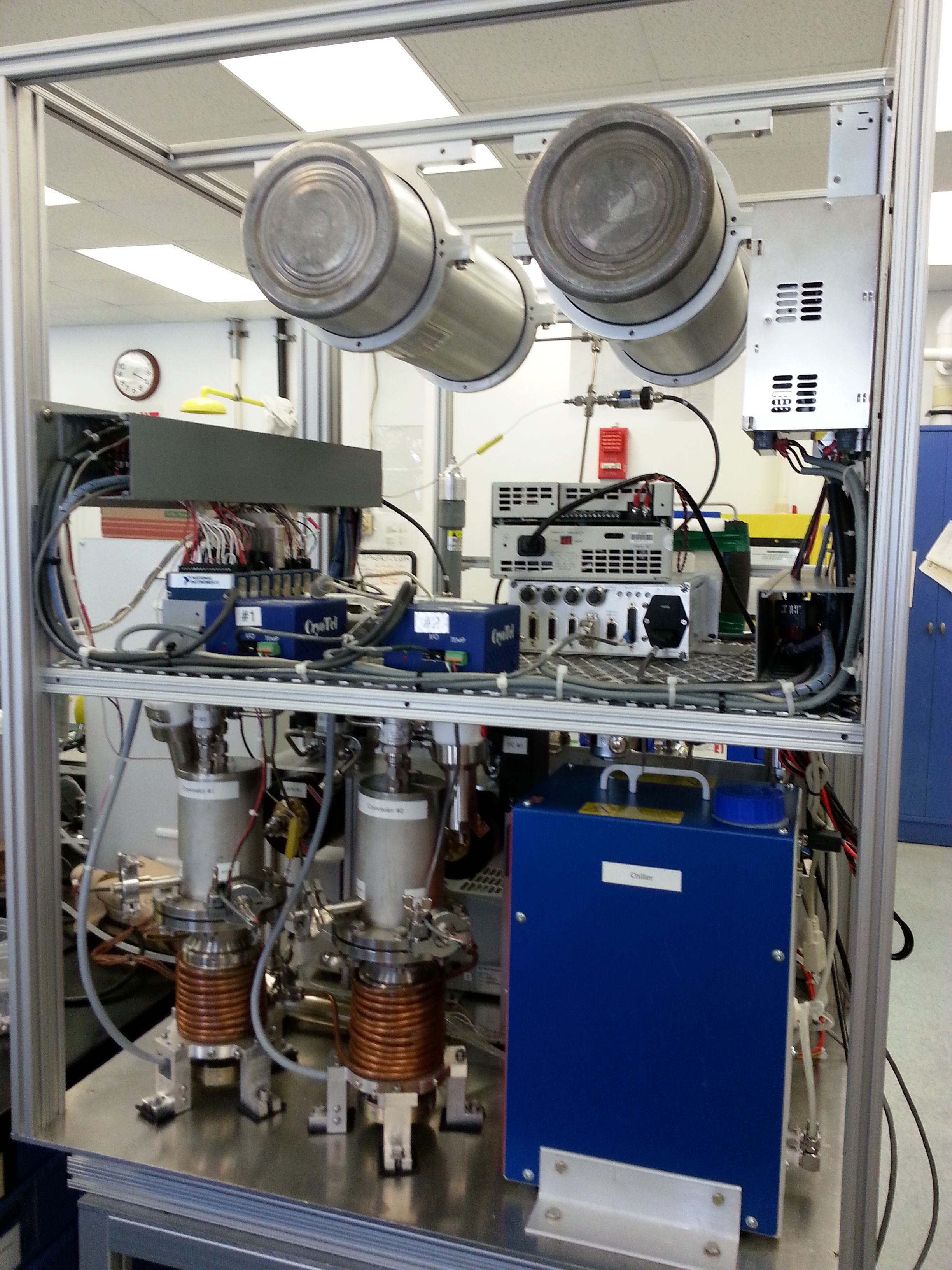 Photo of the MARCO POLO Atmospheric Processing Module CO2 Freezer Subsystem.  The two cryocoolers and freezing chambers are at the lower left.  The CO2 storage tanks are at the top.