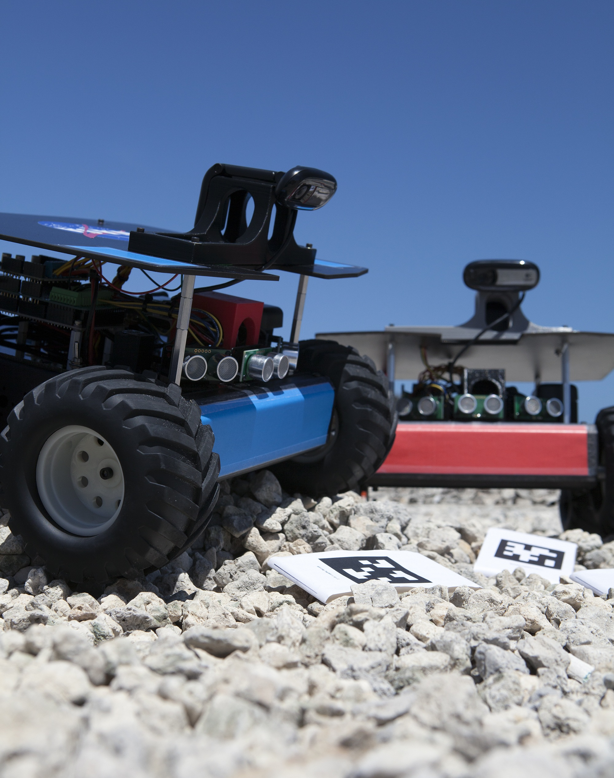 Two Swarmie robots are shown here searching for resources, or bar codes.  NASA photo.