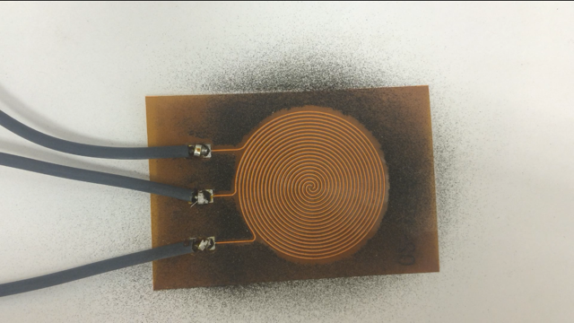Copper-on-Kapton shield shown after expelling dust.