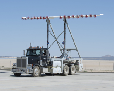 Mounted on a specially modified truck the HEIST ground-test version of LEAPTech was driven at speeds up to 70 mph across a dry lakebed at Edwards Air Force Base