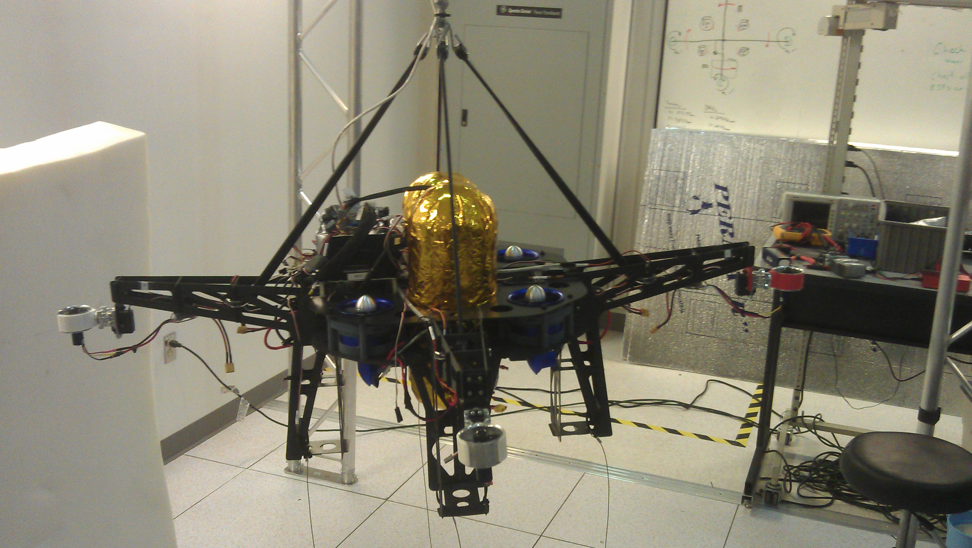 Extreme Access prototype during tethered flight testing.  In later phases, the vehicle's electric ducted fans will be replaced with cold-gas thrusters.