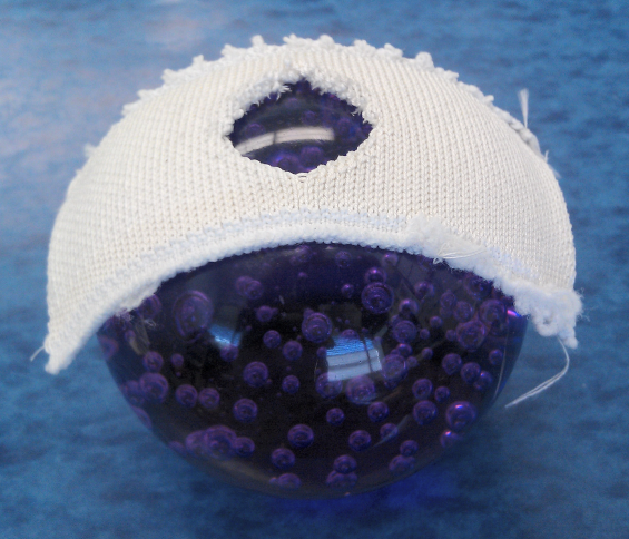 Sample of knitted ceramic fiber structure formed over a 4 cm radius sphere