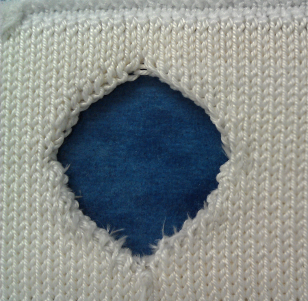 Sample of knitted ceramic fiber structure with hole