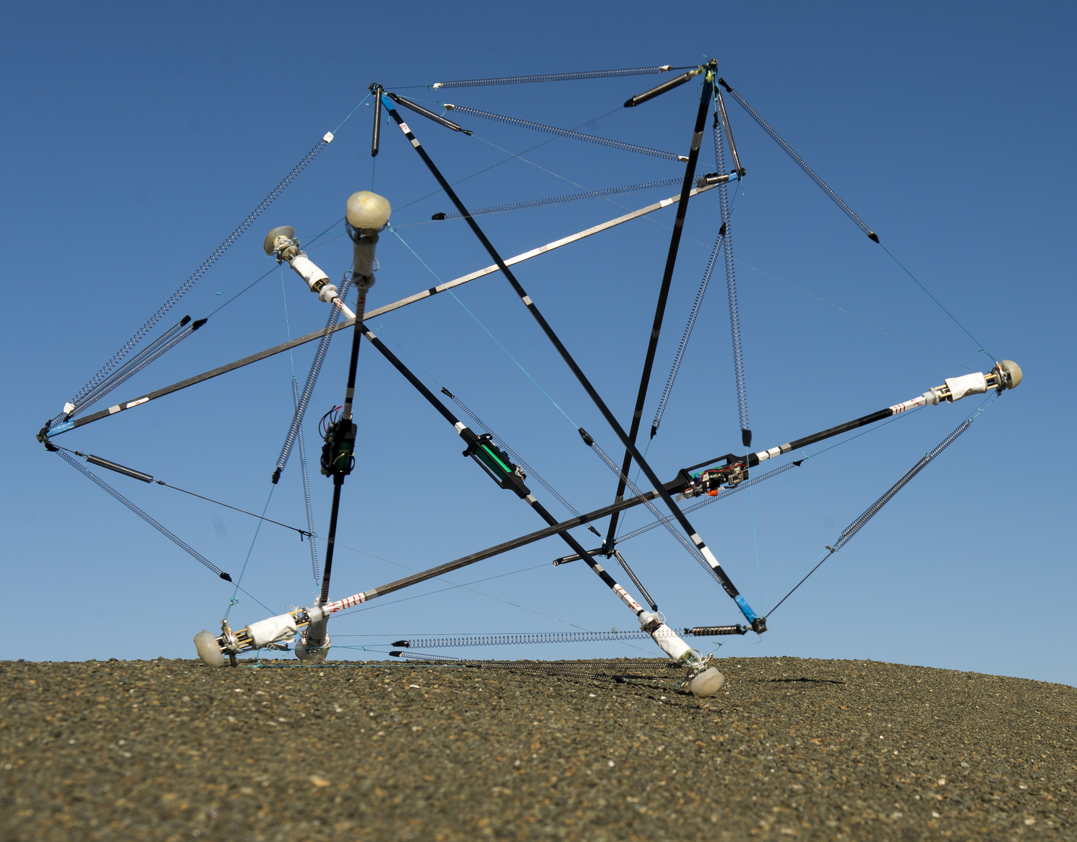 A prototype of NASA's SUPERBall Tensegrity Robot.  This prototype was built by Ghent University's Ken Caluwaerts. This CIF is researching how to transmit power and data over the actuated cables of tensegrity robots.  ©NASA Ames/Eric James.