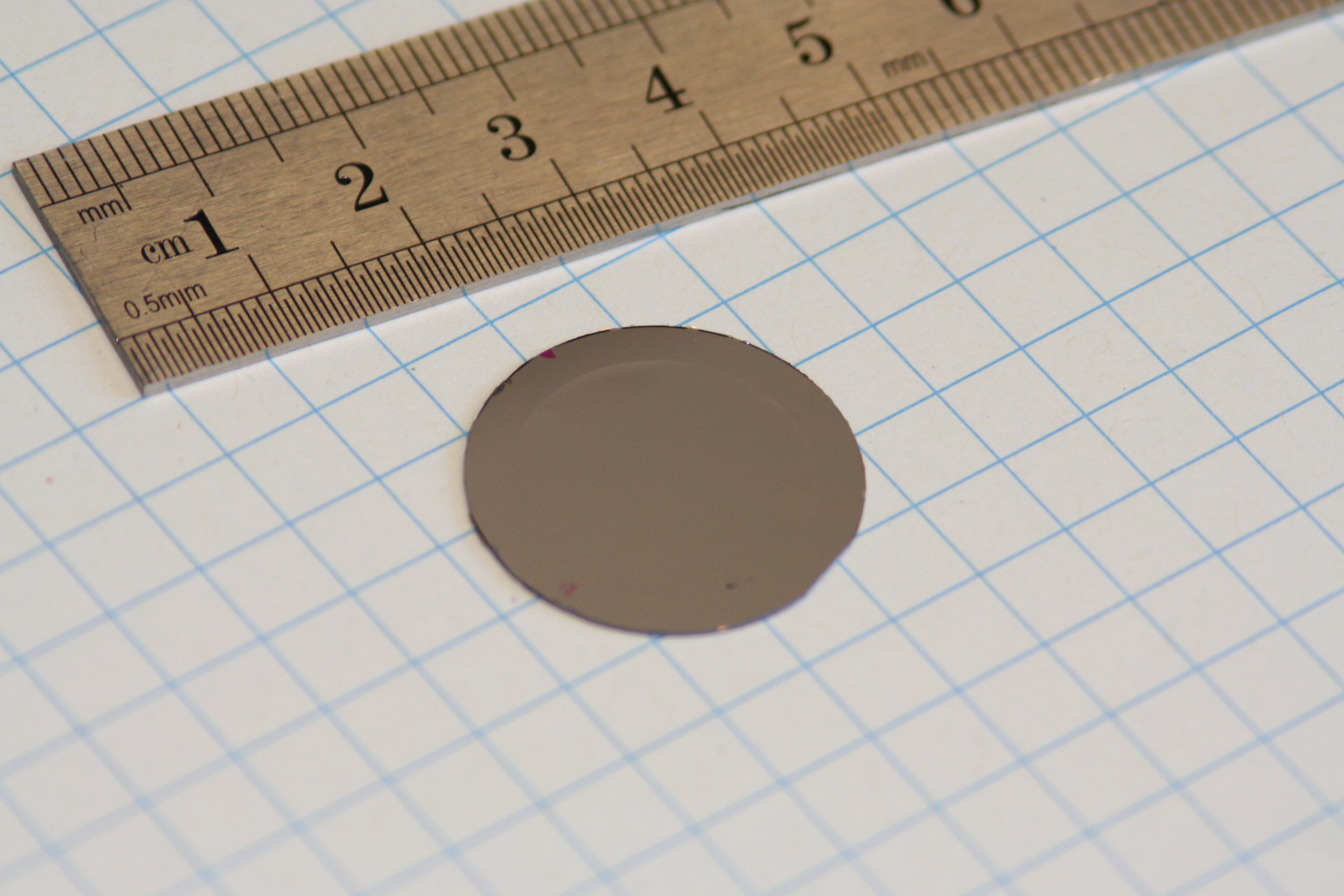 Photo of 18mm diameter mirror 3 layer Silicon mirror