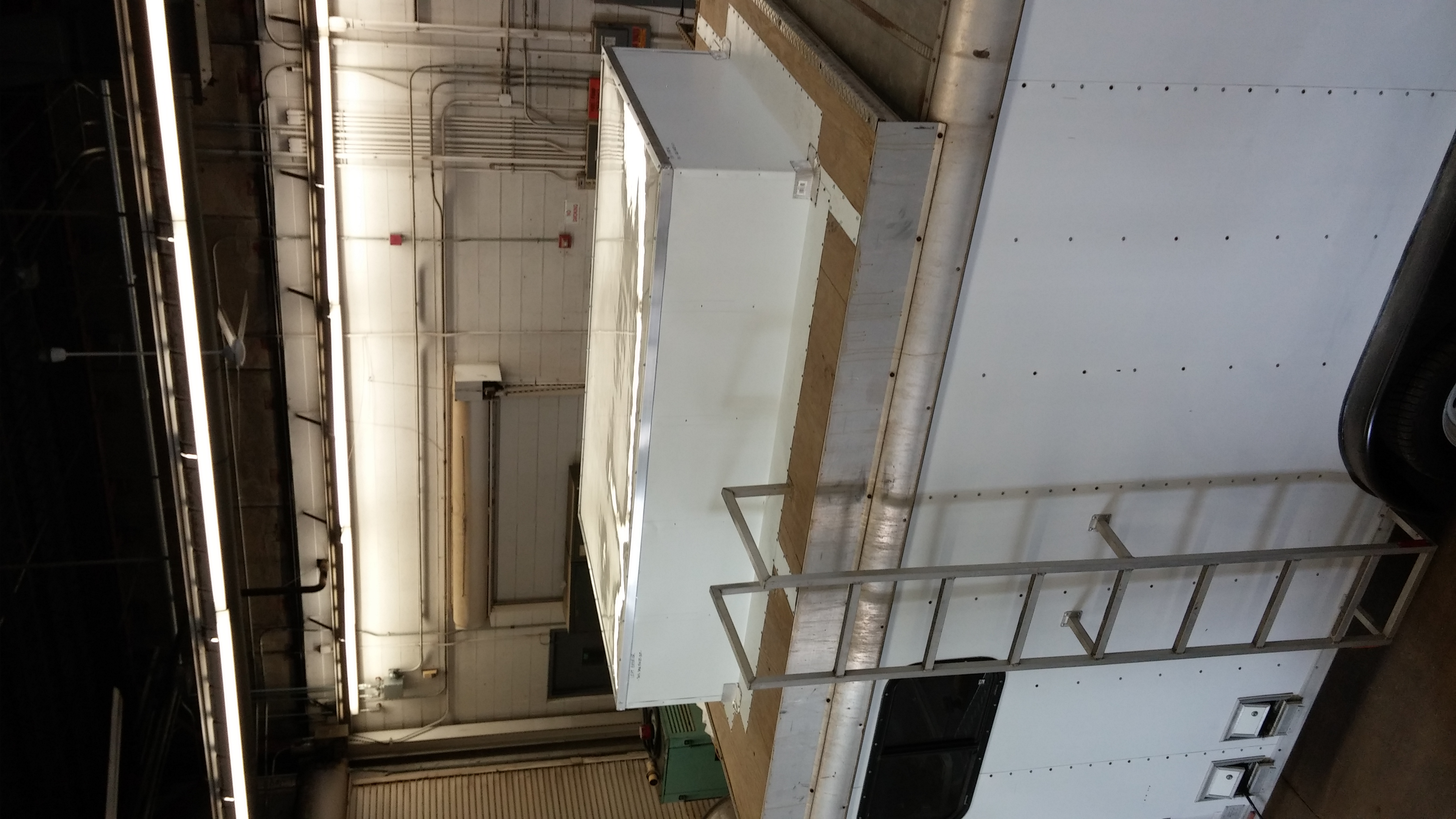 This image shows the custom modification to the X-BADGER research trailer. The top of the white box is a custom built radome that allows for the radar beam to travel through, but protects the interior of the trailer from rain and hail.