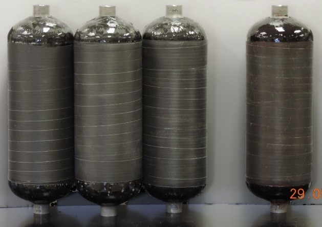 Carbon Fiber-Overwrapped Pressure Vessels (COPV) Manufactured Using Commercial (left) and Ionic Liquid (right) Epoxies